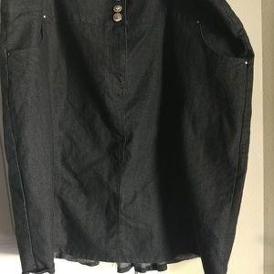 Black denim skirt with stone details.